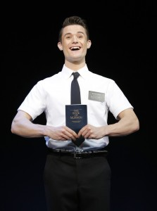 Mark Evans' The Book of Mormon, actor on stage holding the book of mormon, Toronto, Ontario