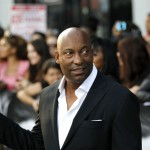 John Singleton giving peace sign
