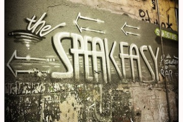the speakeasy written on wall