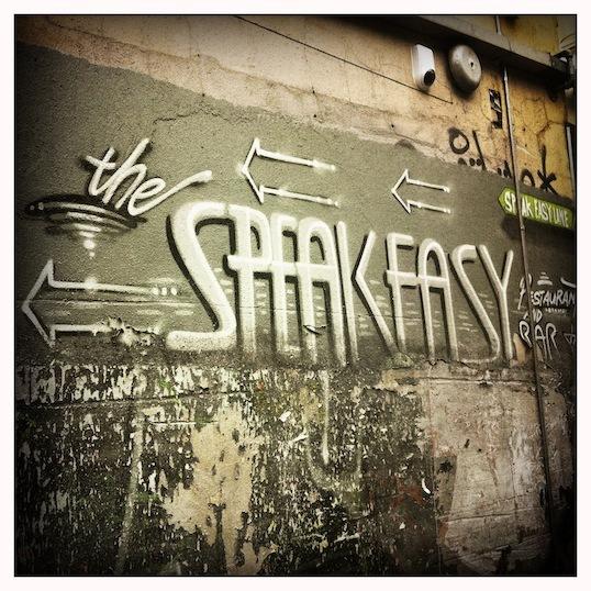 the speakeasy written on wall