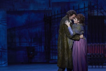 Dimitri Pittas as Rodolfo and Grazia Doronzio as Mimì in the Canadian Opera Company production of La Bohème, 2013. Conductor Carlo Rizzi, director John Caird, set and costume designer David Farley, and lighting designer Michael James Clark. Photo: Michael Cooper