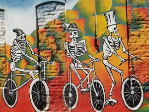 South American artwork tends to be vibrant and colourful, often featuring skeletons and skulls as a pervasive theme.