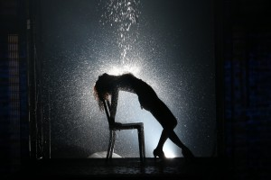 Jillan Mueller as Alex Owens in the famous water scene. Flashdance the Musical.