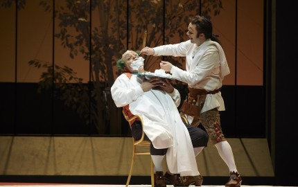 Renato Girolami as Doctor Bartolo and Joshua Hopkins as Figaro in the Canadian Opera Company production of The Barber of Seville, 2015. Conductor Rory Macdonald, director Joan Font, set and costume designer Joan Guillén, choreographer Xevi Dorca and lighting designer Albert Faura. Photo: Michael Cooper