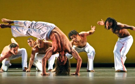"03/18/2009 New York, NY (Culture) - Alisson Silveira (center, in HANDSTAND) and fellow members of DanceBrazil performing in ""Ritmos"" at the Skirball Center at NYU Theater today. Assignment #30078407A Andrea Mohin/The New York Times/Redux  Published 03-23-2009: DanceBrazil members performing Jelon Vieira's ""Ritmos."" (Andrea Mohin/The New York Times/Redux"