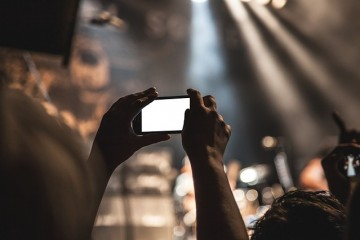 Snapping a pic in a crowd. TheSceneinTO.com Amex and Live Nation collaboration