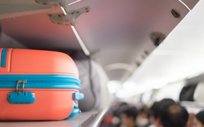 Travel Hacks. 4 Mistakes to avoid on your next trip abroad. TheSceneinTO.com Luggage on plane. shutterstock