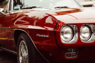 Ford Cherry red firebird. Photo by David Straight on Unsplash