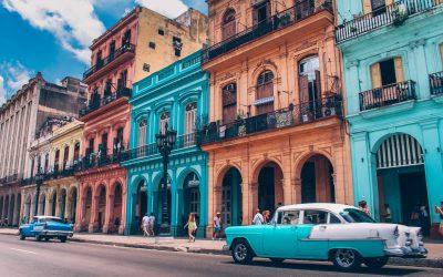 Havana Chronicles. TheSceneinTO.com Visiting Havana. Old Car in front of bueatiful old buildings, Old Havana.