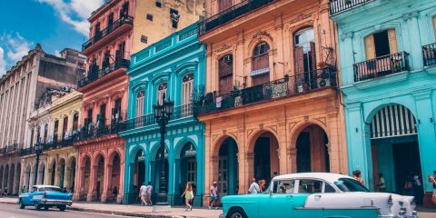 Havana Chronicles. TheSceneinTO.com Visiting Havana. Old Car in front of bueatiful old buildings, Old Havana.